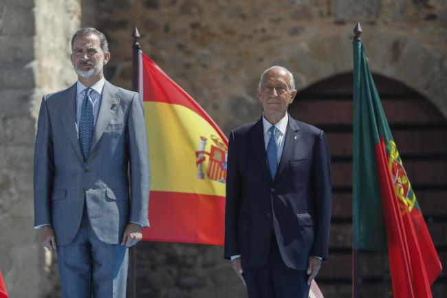 Spain's King Felipe VI, left, and Portugal's President Marcelo Rebelo de Sousa adjust their face masks during a ceremony to mark the reopening of the Portugal/Spain border in Elvas, Portugal (Armando Franca/AP)