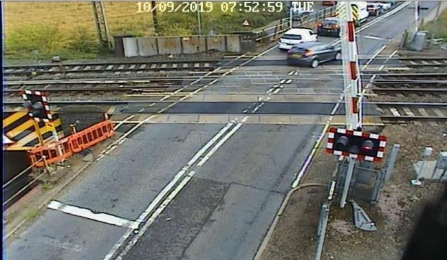 Dangerous - a driver caught on camera jumping the lights at Manningtree level crossing last year