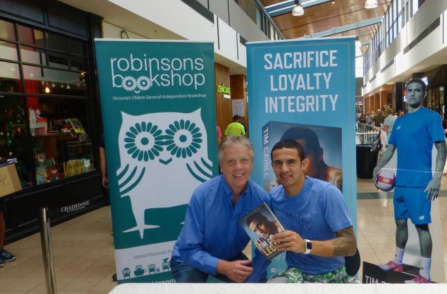 Football chat - Colchester United fan David Pullen (left) with former Everton and Australia star Tim Cahill