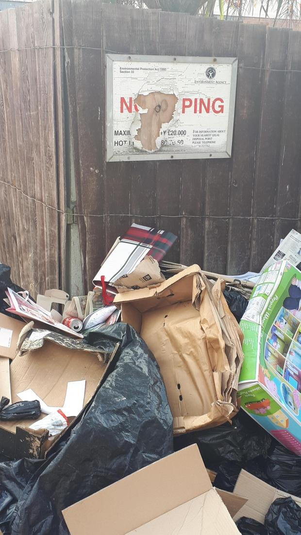 Gazette: NO FLYTIPPING: Rubbish is left right underneath the sign