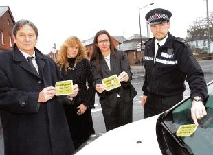 Not kidding – Sgt Fraser Macrae with Ian Taylor and Nikki Nepean, of parking services, and councillor Janet Aldridge