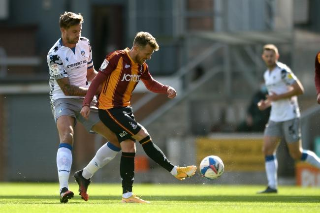 Harry Pell of Colchester United does battle with Billy Clarke of Bradford City - Bradford City vs. Colchester United - Sky Bet League Two - Valley Parade, Bradford - 12/09/2020 - Photo: Richard Blaxall