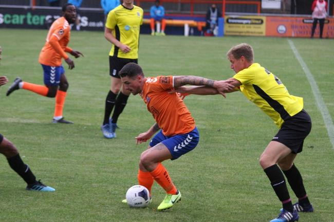 Close attention - Braintree Town's Romario Dunne is well marshalled by ex-Iron defender Alan Massey in Iron's 1-1 friendly draw with Maidenhead United Picture: JON WEAVER