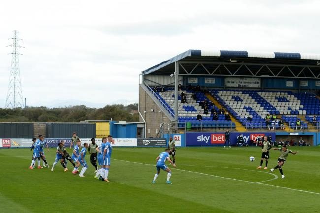 Taking aim - Colchester United left-back Cohen Bramall has a shot at goal at Barrow Picture: RICHARD BLAXALL