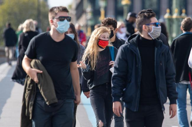 People wearing protective face masks. Picture: Dominic Lipinski/PA Wire
