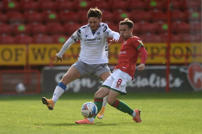 Eye on the ball - Noah Chilvers in midfield action for Colchester United at Walsall Picture: RICHARD BLAXALL