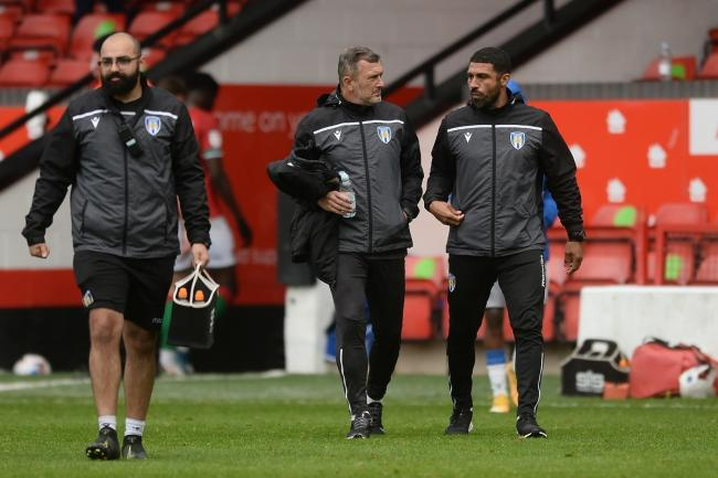 Plans - Colchester United boss Steve Ball (centre) and  assistant manager Hayden Mullins (right) are plotting a victory against Harrogate Town Picture: RICHARD BLAXALL