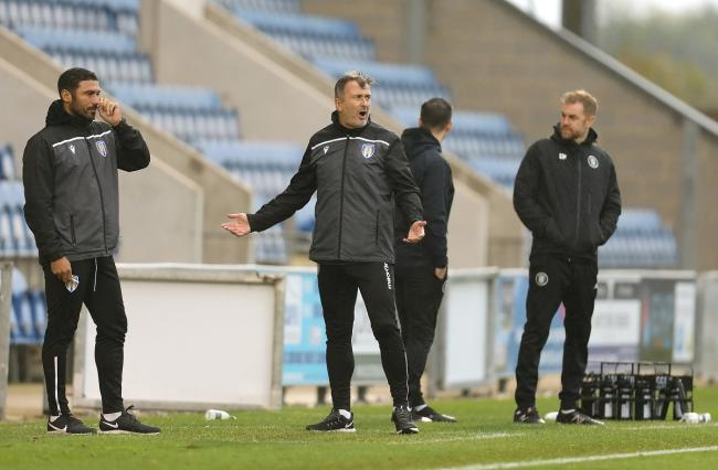 Watching on - Colchester United boss Steve Ball on the touchline, along with Harrogate Town manager Simon Weaver (far right) Picture: STEVE BRADING