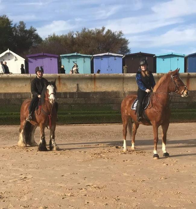 Emily Mathers and her partner on their horses on Frinton beach shortly before the incident