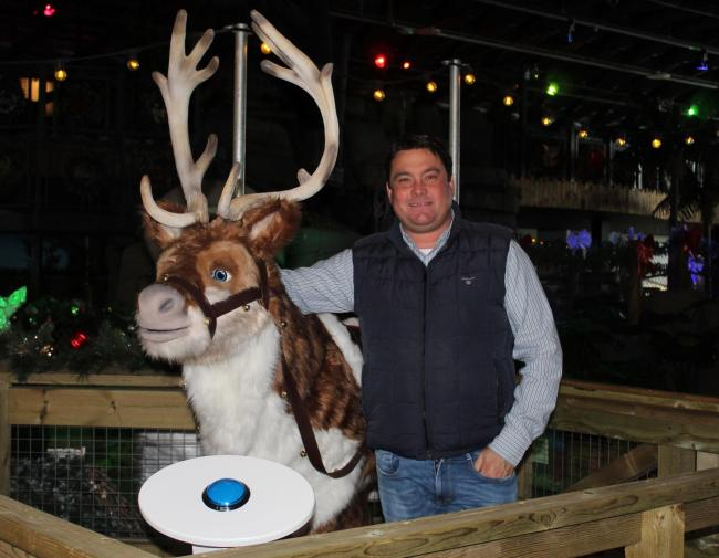 Pier director Billy Ball pictured with the singing reindeer