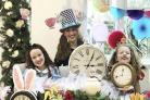 Jessica, Carley, and Sophie Holman. Mum Carly Holman turned her kitchen into a Mad Hatters tea party for her daughter Jessica in lockdown.