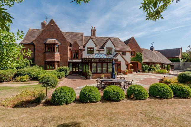 Stunning £4m Aldham home has tennis court, lake and golf course