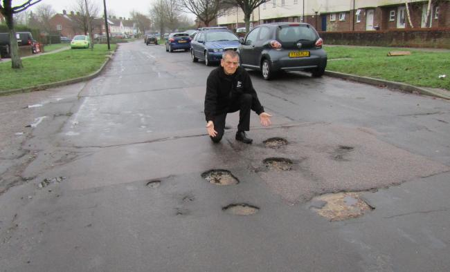 Dave Harris with a group of potholes in Eldred Avenue, Colchester. We have collected some of your selections for the worst ones in Colchester.