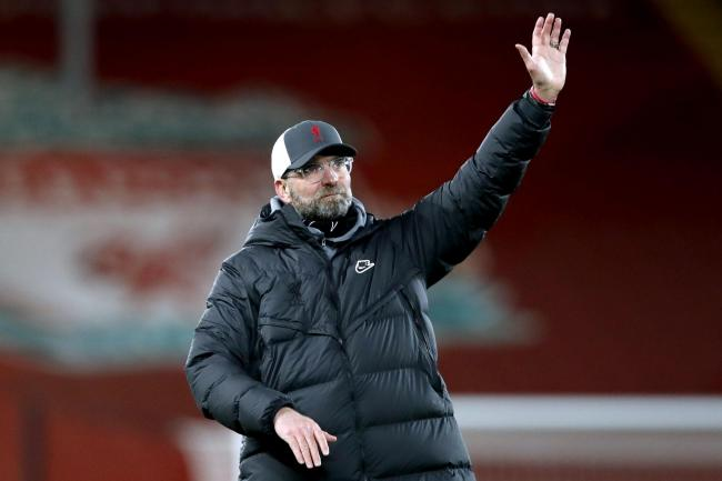 Liverpool manager Jurgen Klopp waves to fans at Anfield