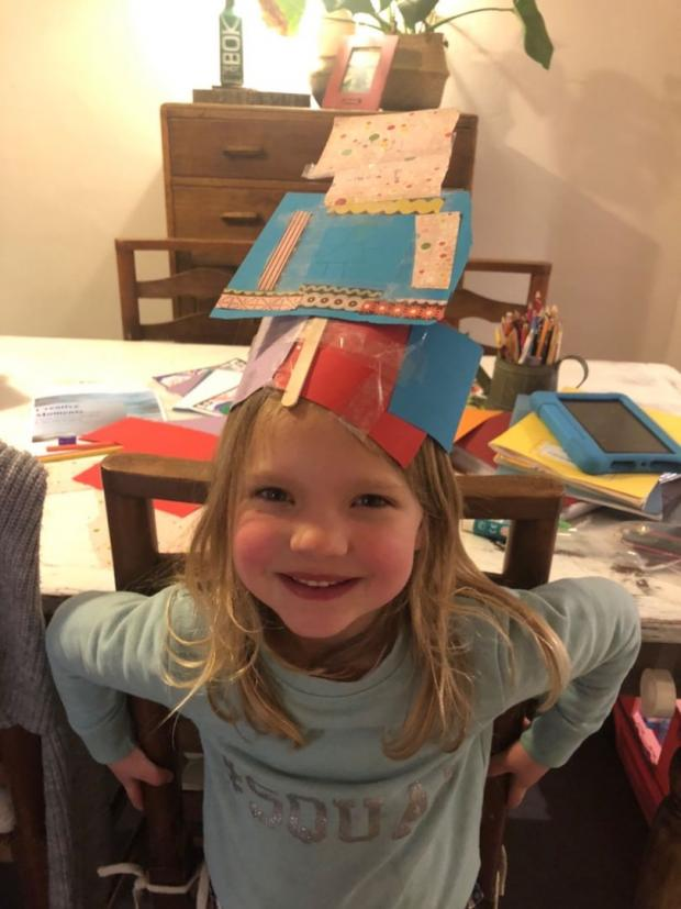 Gazette: Millie Robb, year one, with headwear she created using resources from her Creative Moments pack.