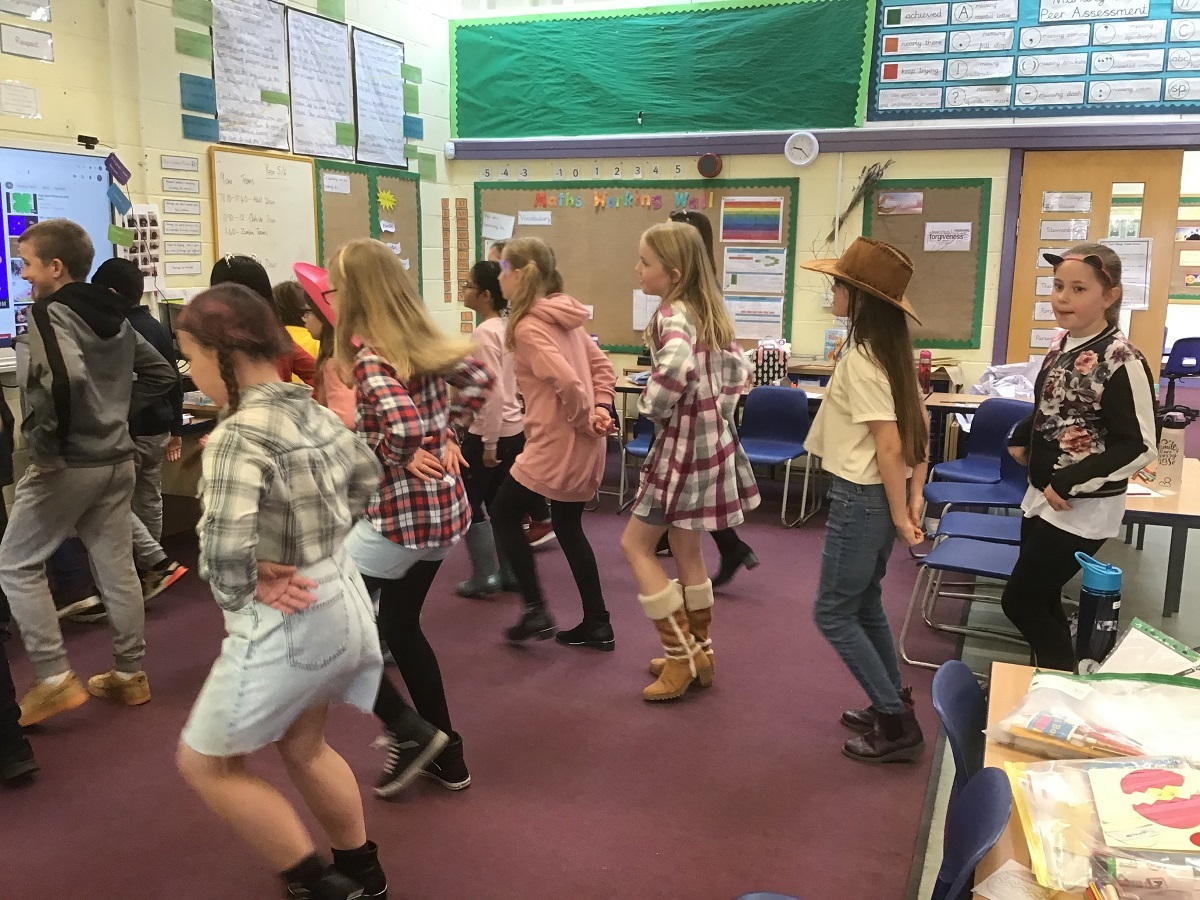 Howdy partner - Year Five saddle up for some fun while line dancing