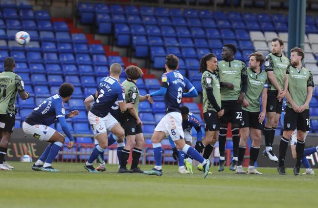 Sinking feeling - Colchester United concede to a free-kick in their 5-2 defeat at Oldham Athletic Picture: STEVE BRADING