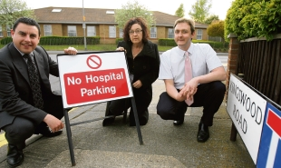 Myland parish councillors Scott Greenhill, Anne Turrell and Martin Goss with one of the signs.