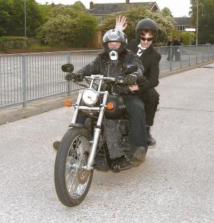 Joe Secrett gets a lift on a motorbike from friend Nick Maxwell