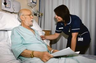Making a difference – specialist nurse Karen Lake advising George  Nicolaides on his condition in Colchester General Hospital