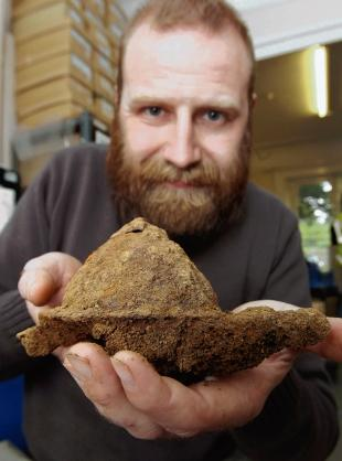 Look at this! Archaeologist Adam Wightman with part of a shield found at the old barracks