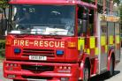 Fire breaks out behind wood burner in house
