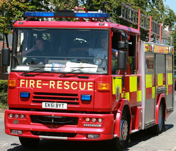 Crews called to woman stuck in flood water during fire strike