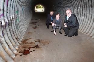 Charles Simpson, Kelly Foale and Andrew Everett view conditions in the underpass