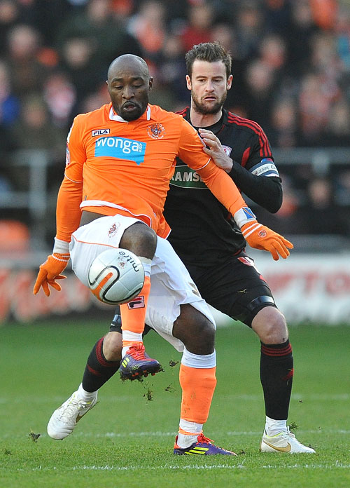 Happy homecoming - could Lomana Lua Lua, seen here playing for Blackpool in 2012, make a welcome return to Colchester United this summer?