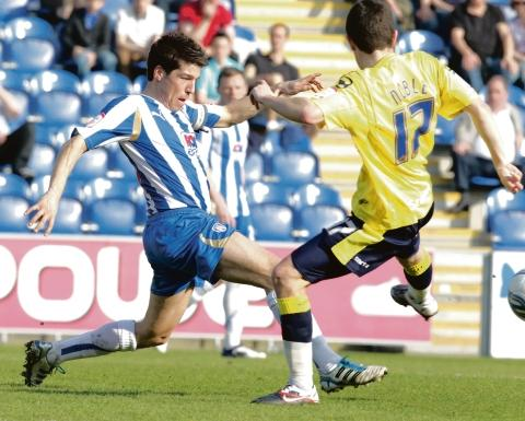 Hoping to stay - Colchester United skipper Kem Izzet (left) is close to signing a new contract with the club. Picture: STEVE BRADING (CO54785-04)