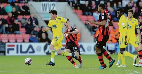 Making strides - Colchester United's Ian Henderson moves towards goal during Colchester United's 1-1 draw with Bournemouth. Picture: WARREN PAGE