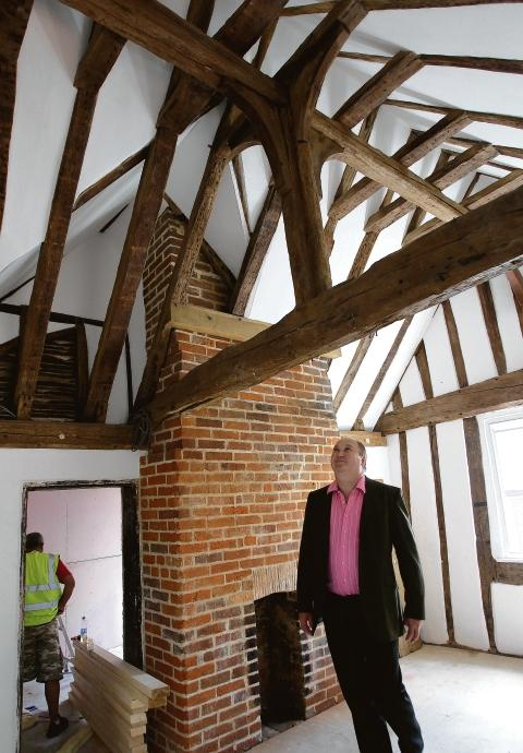 Robert Morgan walks through the new manager's quarters of the refurbished Stockwell Arms