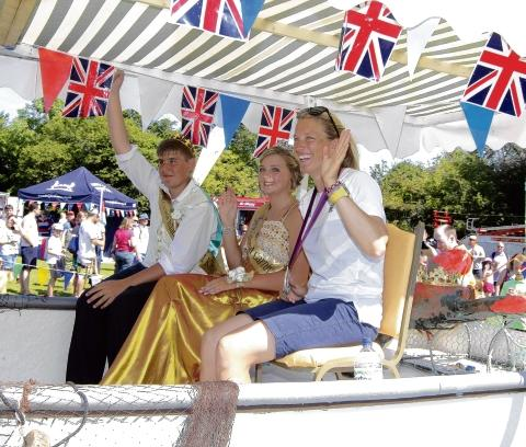 A royal welcome home – Mersea carnival's King Alfie Wood, Queen Molly Munson and princess Saskia Clark