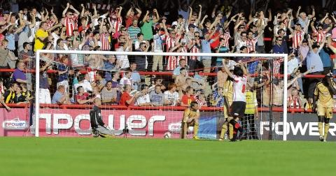 Despair - Colchester United concede a late goal to lose 1-0 at Brentford on Saturday. Picture: WARREN PAGE