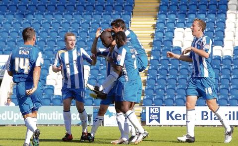 On target - Magnus Okuonghae celebrates his goal with his Colchester United team-mates during their 2-1 home defeat at the hands of Doncaster Rovers. Picture: ADRIAN RUSHTON (CO69248-115)