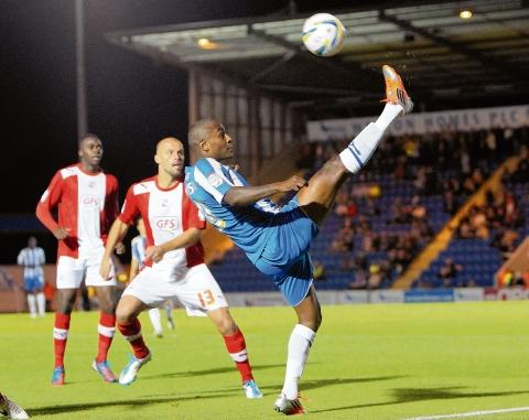 High kicks - Clinton Morrison battles for possession in Colchester United's 1-1 draw with Crawley Town. Picture: STEVE ARGENT (CO69249-02)