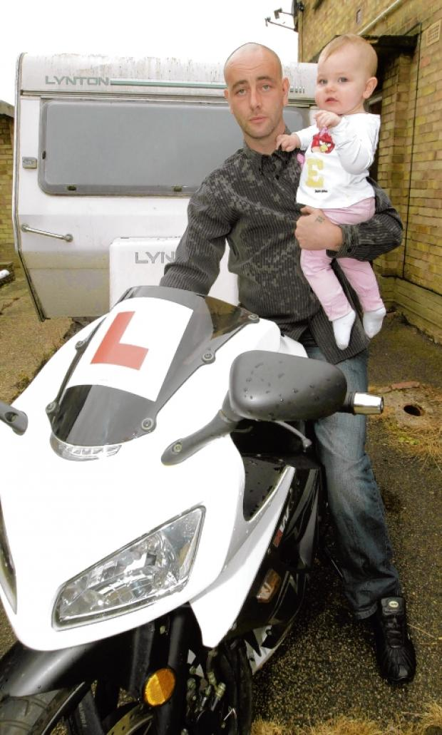 Gavin Hindle with daughter Ella-Rose, by his new motorbike.