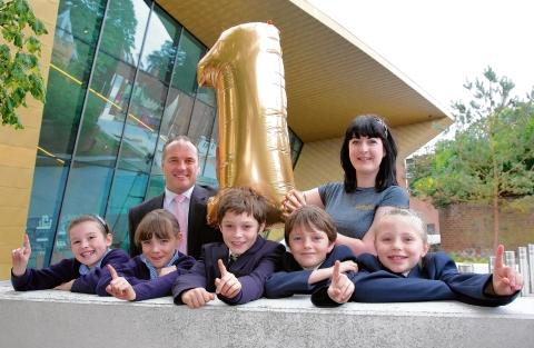 Birthday celebrations: Wayne Warner, commercial director, and Bethan Jones with St Thomas More's Primary School pupils Jessica Stebbing, Louisa Hayes, Alfie Kelway, Owen Moriarty and Hannah MacKay.