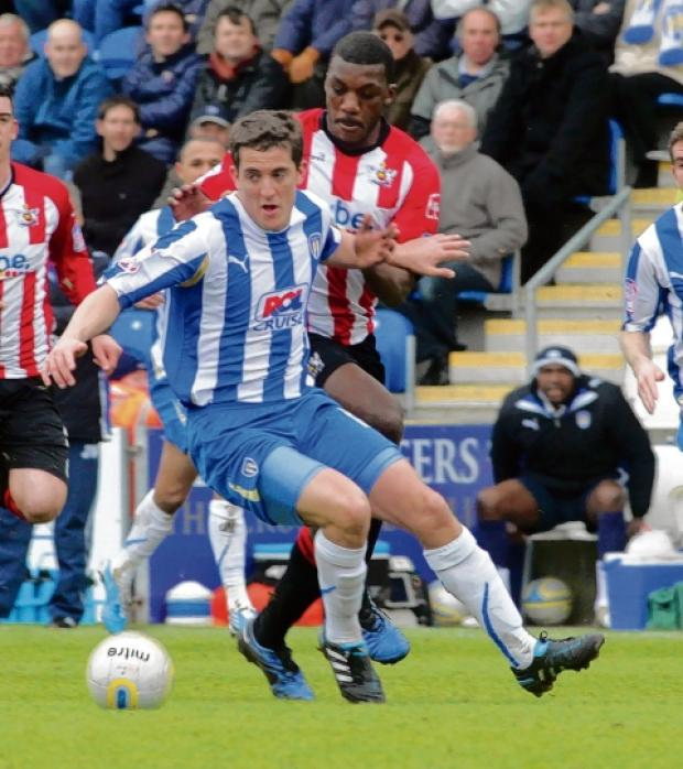 Challenge - Andrew Bond can force his way back into Colchester United's starting line-up, despite going out on loan at Crewe Alexandra.