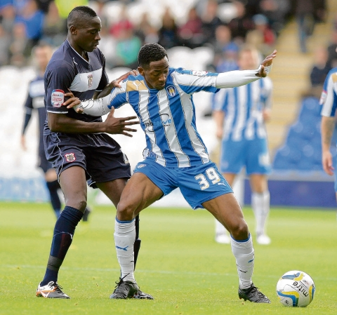 On target - Colchester United's Sanchez Watt (right) in action against Stevenage. Picture: SEANA HUGHES (CO70543-01)