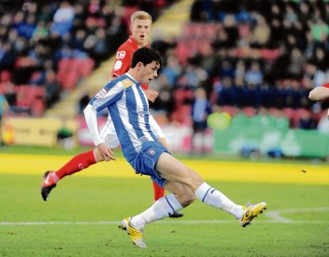 Super strike - Ian Henderson chips in Colchester United's second goal in their 3-2 defeat at Crewe Alexandra, on Saturday. Picture: WARREN PAGE