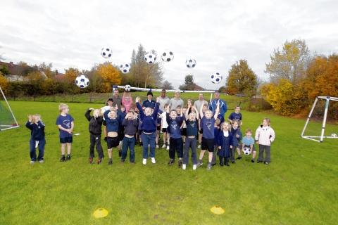 Having a ball: Langenhoe Primary School pupils and U's players Bradley Hamilton and Jordan Sanderson
