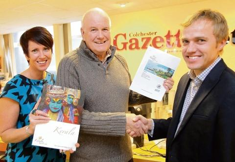 Gazette prize winner Malcolm Smith (centre) receives his prize from Nigel Barton, managing director of Kerala Travel Centre and Tanya R