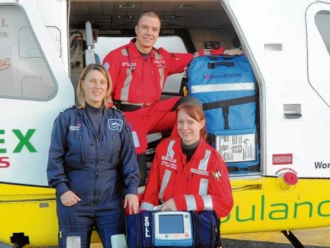 Air ambulance pilot Nicky Smith, Dr Adam Chesters and paramedic Erica Ley showcasing the new life-saving equipment, a critical care monitor