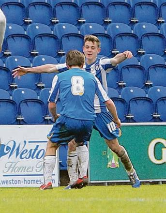 All smiles - Sam Szmodics celebrates his goal against Chelsea, in the FA Youth Cup. Picture: STEVE ARGENT (CO72711-26)