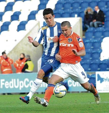 Tussle - U's midfielder Andy Bond battles with Oldham's James Wesolowski during Colchest