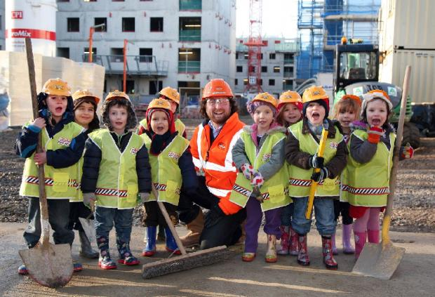 Youngsters from the Essex University Day Nursery meet construction site manager Nicolas Villepinte.