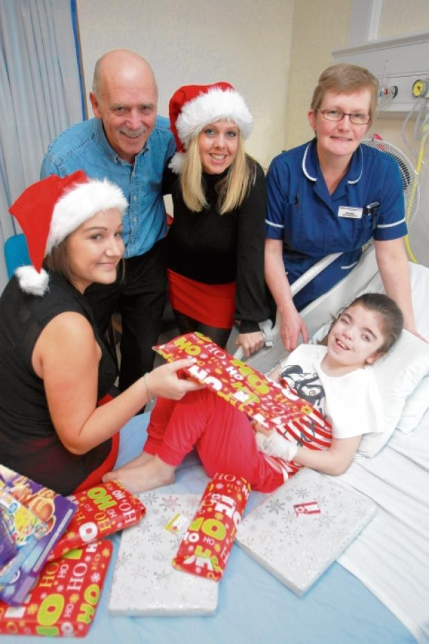 Recruitment consultatants Louise Thomas & Susie Dow deliver toys for youngsters on the Children's Ward at Colchester General Hospital. Pictured with hospital staff Sister Kim Ness & Graham Appleton with patient Siobhan Roper.