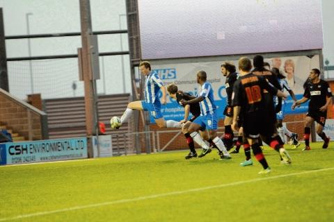 Going close - Tom Eastman steers a chance just wide in Colchester United's 3-1 defeat against Brentford. Picture: STEVE ARGENT (CO73751-08)