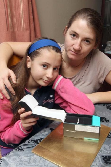 Emma De'Ath, from West Bergholt, with daughter Jade, 12, who had her Blackberry phone and Christmas present money stolen while shopping in Colchester.